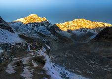 Morning view of Mount Annapurna view from Annapurna base camp. With prayers flags Nepal royalty free stock images