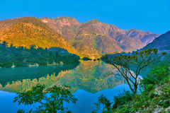 Morning view of mountains. Mirror view of mountains and river in the morning Stock Photo