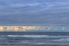 Morning view of the ocean with waves and beautiful clouds in Vic Royalty Free Stock Images
