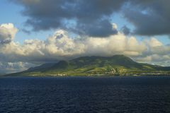 A morning view over Saint Kitts Island with mountain tops covered with clouds Stock Images