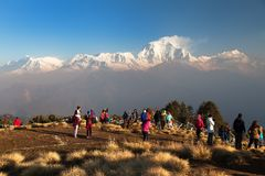 Morning view of Poon hill with tourists Stock Photo
