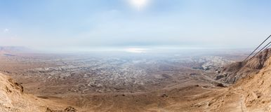 Morning view  from ruined Masada fortress to the Judean desert in Israel. Morning view from ruined Masada fortress to the Judean desert in Israel royalty free stock images