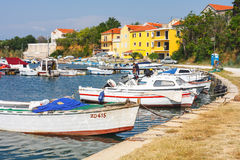 Morning view on sailboat harbor in Porat with many moored boats and yachts, Croatia. Porat, Croatia, 09 JULY 2010: Morning view on sailboat harbor in Porat with Stock Photo