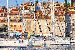 Morning view on sailboat harbor in Rovinj with many moored sail boats and yachts, Croatia Stock Photo