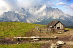 Morning view from Sexten Dolomites with chalet Royalty Free Stock Image