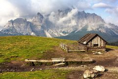 Morning view from Sexten Dolomites with chalet Stock Images