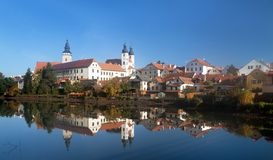 Morning view of Telc or Teltsch town mirroring in lake Stock Photo