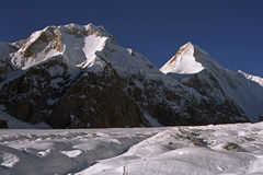 Morning view to Chapaev peak 6371m on the left and Khan Tengri peak 6995m. Stock Images