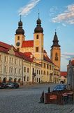 Morning view to the main square of the city Telc and Name of Jesus Church Kostel Jmena Jezis. TELC, THE CZECH REPUBLIC-AUGUST 26, 2017: Morning view to the main Stock Photography