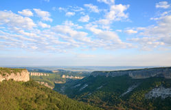 Morning view from top of Mangup ancient settlement. Morning view from top of Mangup Kale - historic fortress and ancient cave settlement in Crimea (Ukraine Stock Photo