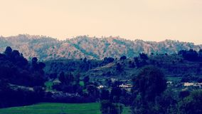 Morning view of a village. This village in azad kashmir , its name is khadal and this photo represents the sunlight falling on mountains in the morning stock images