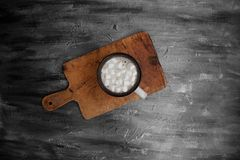 Cup of Coffee om Wooden Board on Black Table Stock Photo