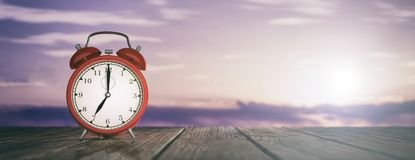 Morning wake up. Alarm clock on a sky at sunrise background. 3d illustration. Morning early wake up concept. Alarm clock on a sky at sunrise background. 3d Stock Photo