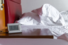 morning wake up with alarm clock  and white bedding sheets and p Stock Photography