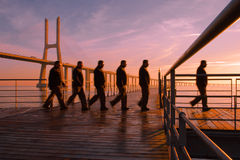 Morning Walk. Man walking on a pass-way over the river Tagus with Vasco da Gama bridge on the background Stock Image