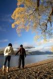 Morning Walk. Lake and a couple walking enjoying beautiful view of New Zealand mountains Royalty Free Stock Images