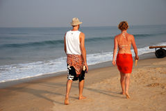 Morning walk. By couple at Goa beach, India Stock Photography