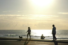 Morning Walk. By Surfers Paradise beach,Gold Coast, silhouette Stock Photo