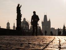 Morning walk on Charles bridge in Prague Royalty Free Stock Images