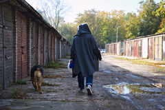 Morning walk with a dog in Warsaw. A girl walking his dog on a beautiful sunny autumn morning Royalty Free Stock Photos