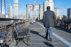 Morning walk over Brooklyn Bridge Royalty Free Stock Photography