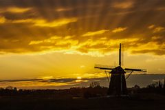 Sunset on the Dutch windmill Stock Photography