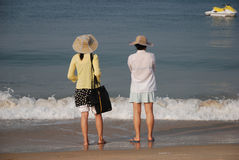 Morning watch. Women at Goa beach, India Stock Photo