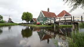 Zaanse Schans cheese factory reflection. Morning water reflection of the Zaanse Schans cheese factory on the calm water before the arrival of the mass tourism stock video