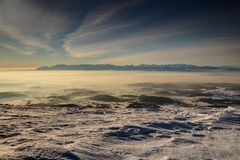 Morning wide angle view of entire Tatra range above glowing fog stock images