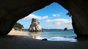 Morning shot of rock arch at cathedral cove. Morning wide view from the rock arch at cathedral cove at hahei, new zealand stock video footage