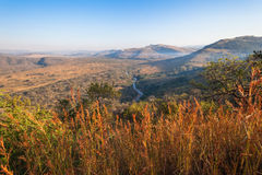 Morning Wildlife Terrain Landscape. Blue sky and african bush scenic colors contrasting in the morning sunlight overlooking the valley river nzimane and hill Royalty Free Stock Images