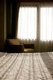 Morning window. A modern, comfortable bedroom during the morning Stock Photography