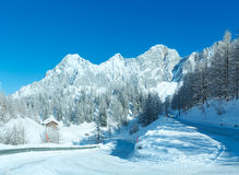 Morning winter alpine road. Royalty Free Stock Images