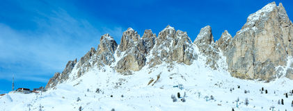 Morning winter Gardena Pass panorama with ski station (Italy). A Royalty Free Stock Photo