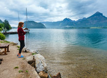 Wolfgangsee summer lake (Austria) and woman. Stock Photo