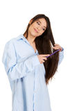 Morning woman in big shirt combing hair. Stock Photo