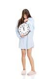 Morning woman in big shirt holding clock. Stock Photos
