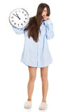 Morning woman in big shirt holding clock. Stock Images