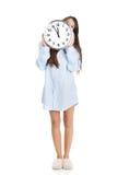 Morning woman in big shirt holding clock. Royalty Free Stock Photo