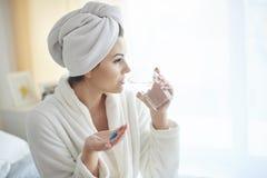 Morning. Woman taking pill at the morning Royalty Free Stock Photos