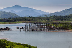 Morning at wooden bridge is the second longest in the world in  thailand Stock Photo
