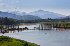 Morning at wooden bridge is the second longest in the world in  thailand Royalty Free Stock Images
