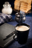 Morning work. Morning a cup of coffee and a notepad royalty free stock image