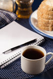 Morning work. Morning a cup of coffee and a notepad royalty free stock photos