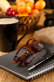 Morning work. Morning a cup of coffee and a notepad royalty free stock photography