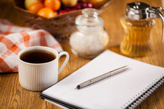 Morning work. Morning a cup of coffee and a notepad royalty free stock images