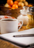 Morning work. Morning a cup of coffee and a notepad royalty free stock photo