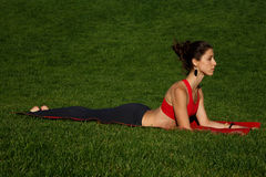 Morning workout. meditation. Woman practices yoga in nature Stock Images