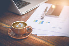 Morning workplace: cup of coffee with latte art and business objects Stock Images
