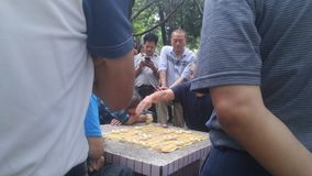Shenzhen, China: middle-aged and elderly men play chess. In the morning, in Xixiang Park of Shenzhen, the middle-aged and old men played chess as entertainment royalty free stock image